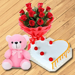 Glamorous 12 Dutch Red Roses with Teddy Bear and 1/2 Kg Heart Shaped Cake