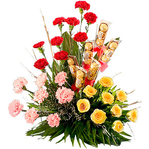 Send Charming mixed Flowers added with yummy Ferrero Rocher Chocolates delight to Kerala