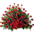 Send 100 Dutch Red Roses in a slendid arrangement to Kerala