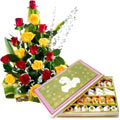 Send Admirable colorful mixed Roses and palatable assorted Sweets to Kerala