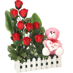 Blossoming Nine Red Roses with a Teddy with Heart