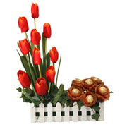Send Long Lasting �  Orange Tulips with eatable Original Ferrero Rochers to Kerala