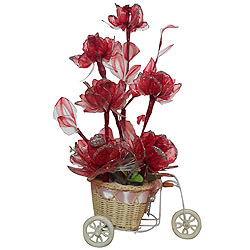 Pretty Red Artificial Flowers in a Tricycle Basket