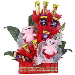 Enticing Arrangement of Pink Teddies N Cadbury Chocolates in a Basket