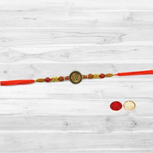 Beautifying Rakhi with Om at the Center