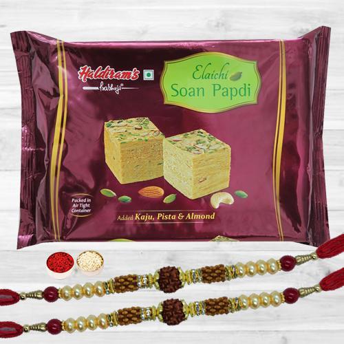 Elegant Rudraksha Rakhi Pair N Tasty Soan Papdi, Roli Chawal N Card