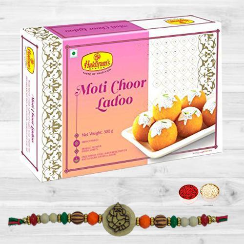 Ravishing Ganesh Rakhi N Tasty Motichoor Laddoo with Card N Roli Tika