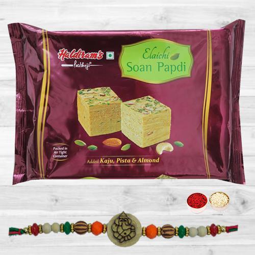 Splendid Ganesh Rakhi N Yummy Soan Papdi with Free Roli Tika N Card