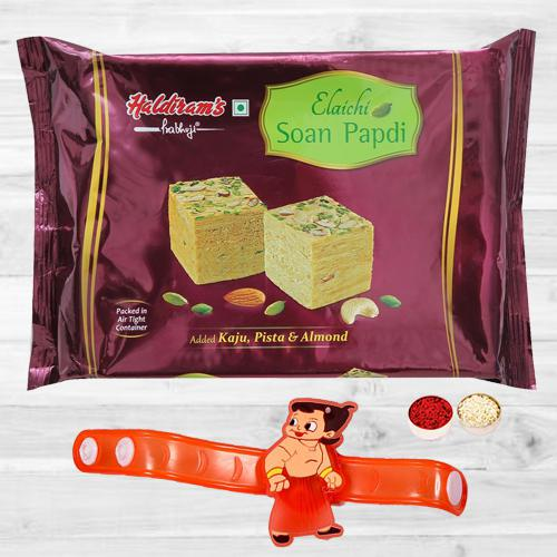 Trendy Chota Bheem Rakhi N Yummy Soan Papdi with Roli Tika N Card