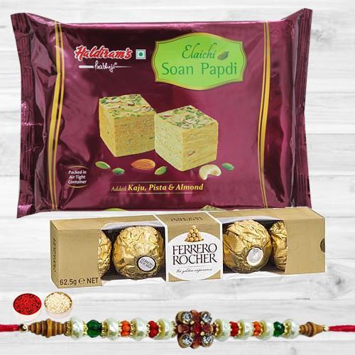 Graceful Stone Rakhi with Delicious Chocolate N Mithai Combo