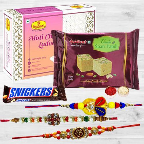Lovely Rakhi Trio Set with Delicious Chocolates N Mithai