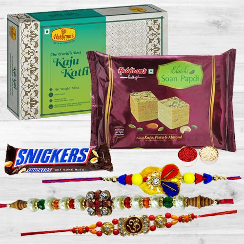 Dazzling Rakhi Trio Set with Sweets N Chocolate Assortments
