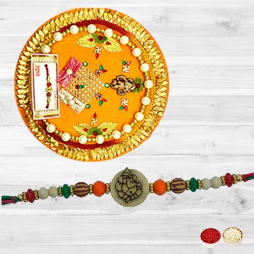 Fabulous Single Ganesh Rakhi N Thali Combo with Roli Tika N Card
