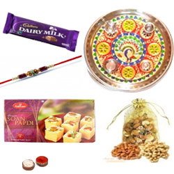 Fabulous Display of Rakhi with Puja Thali, Soan Papdi, Dairy Milk Chocolate and Assorted Dry Fruits