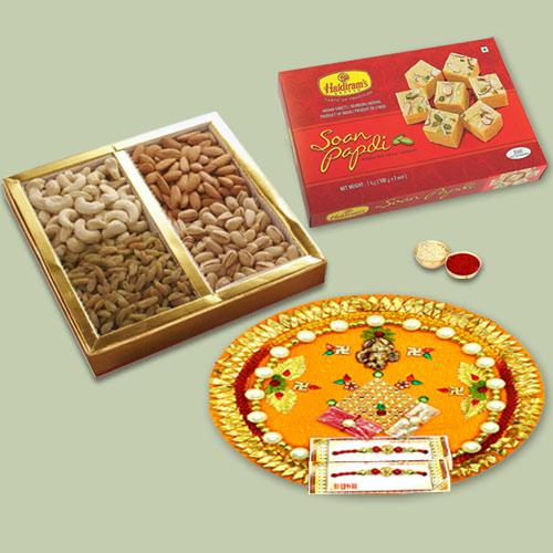 Dazzling Gift of Soan Papdi, Assorted Dry Fruits N Puja Thali with Bhaiya Rakhi