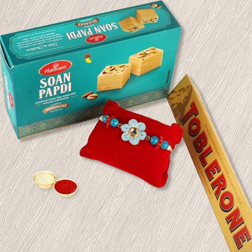 Classy Gift of Rakhi with Toblerone and Soan Papdi