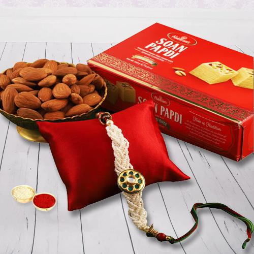 Tasty Soan Papdi with Fancy Rakhi and Almonds