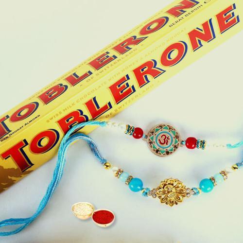 2 Fancy Rakhis, Free Roli Chawal, Rakhi Card N Toblerone Chocolate