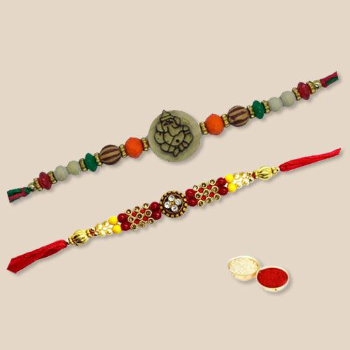 Impeccable Set of 2 Rakhis, Free Roli Chawal and Wishes Card