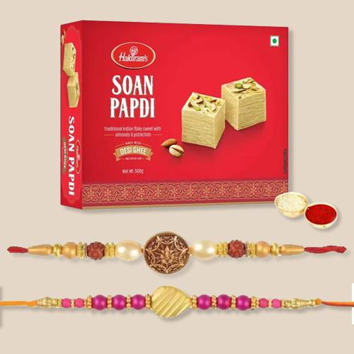 Tasty Soan Papdi with 2 Rakhis, Free Roli Chawal and Wishes Card