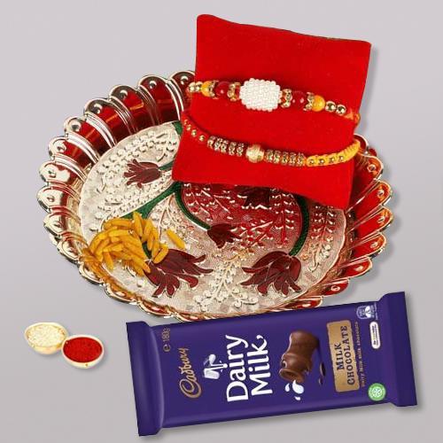 Tasty Cadbury Dairy Milk N Fancy Thali with 2 Rakhis, Free Roli Tika