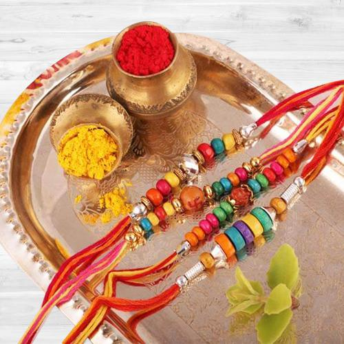 4 Colorful Rakhis with Message Card N Free Roli Chawal