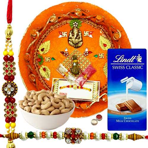 Heart Winning Rakhi Combo Of 2 Rakhi, Rakhi Thali, Cashews N Lindt Swiss Chocolate