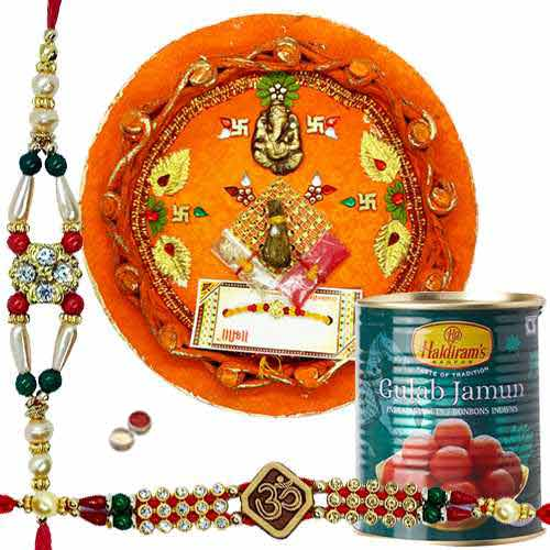 2 Captivating Rakhi, Pooja Thali And Haldiram Gulab Jamun.