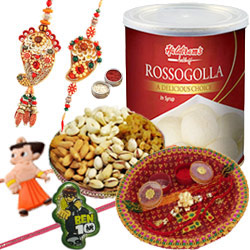 Charming Combo Of Bhaiya Bhabhi Rakhi Set, 2 Kid Rakhi, Mixed Dry Fruits, Haldiram Rasgulla And Pooja Thali.