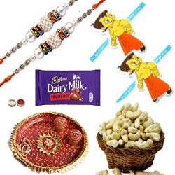 Spellbind Combo Of Bhaiya Rakhi, Kids Rakhi, Cashew, Fruits N Nut Cadbury Dairy Milk And Pooja Thali