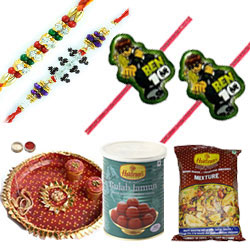 Mesmerizing Combo Of Fetching Bhaiya Rakhi, Kids Rakhi, Haldirams Mixture, Gulab Jamun and Pooja Thali