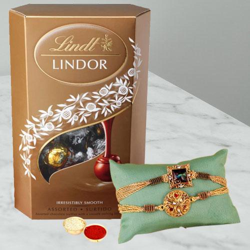 Pious Twin Rakhi Set with Lindor Truffles, Roli Tika n Card