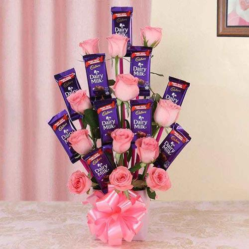 Wonderful Arrangement of Roses with Cadbury Dairy Milk Chocolates