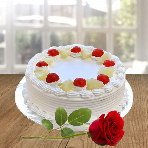 Exquisite Vanilla Cake and a Fresh Red Rose