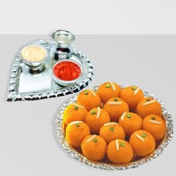 Send Silver Plated Paan Shaped Puja Aarti Thali (weight 52 gms) with Motichur Laddu from Haldiram to Kerala