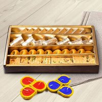 Assorted Sweets from Haldiram with wax Diya