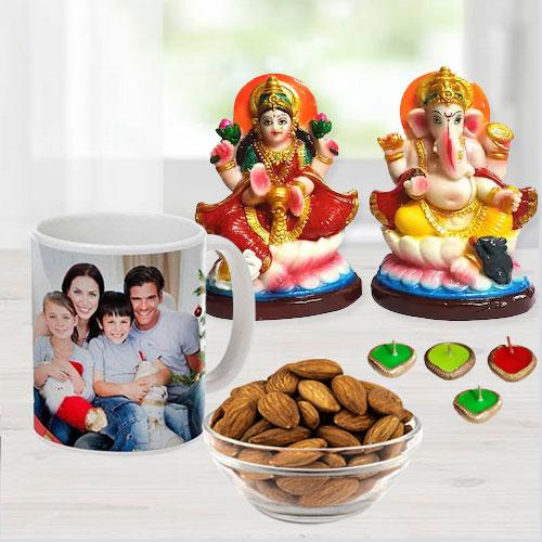 Attractive Ganesh Laxmi Idol with Personalized Coffee Mug, Cadbury Chocolates n Almonds, Free Wax Diya