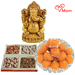 Auspicious Idol of Sandalwood Ganesha and 250 gms. each of Haldiram's Ladoo and Dry Fruits
