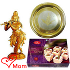Intricate Krishna made of Sandalwood and Sweets Hamper