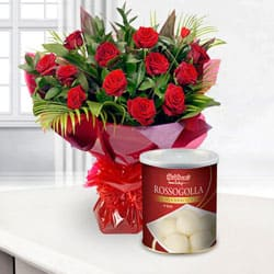 Send Gorgeous 12 Red Roses and 1 Kg. Haldiram Rasgulla to Kerala