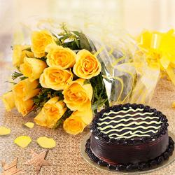 Tasty Chocolate Cake n a Bouquet of Yellow Roses