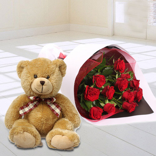 Lovable Teddy Bear with Red Roses