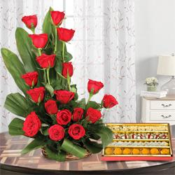 Send Exquisite 18 Red  Roses with delicious heavenly mixed Sweets to Kerala