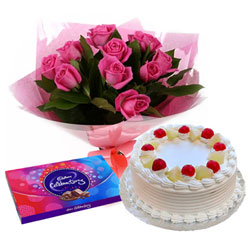 Order Pink Rose Arrangement with Cake and Cadbury Celebration