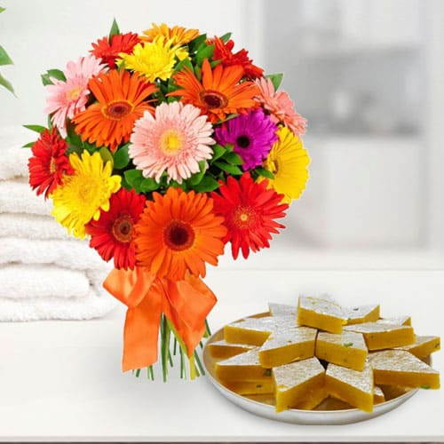 Anniversary Combo of Delicious Kaju Katli and Gorgeous Arrangement of Mixed Gerberas