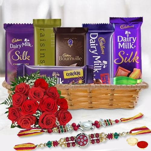 Gift Hamper of Cadbury Chocolates with Red Roses with 2 Rakhi, Roli, Tilak and Chawal