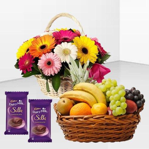 Online Dairy Milk Silk with Mixed Fruits Basket and Gerberas Arrangement