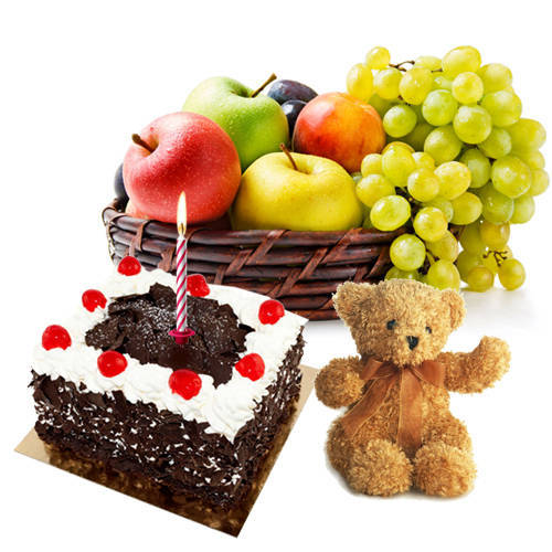 Sending Teddy with Candles, Fresh Fruits Basket and Black Forest Cake