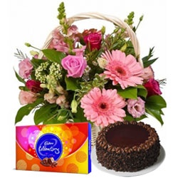 Send Chocolate Cake with Seasonal Flowers Basket and Cadbury Celebrations