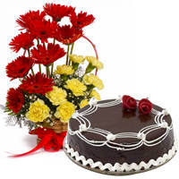 Send Pretty Carnations and Gerberas and Dark Chocolate Cake to Kerala
